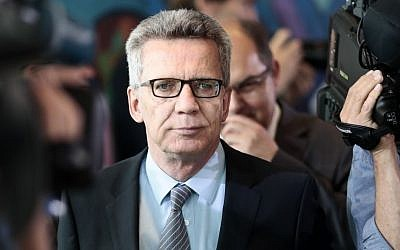German Interior Minister Thomas de Maiziere arrives for the cabinet meeting at the chancellery in Berlin, Germany, Wednesday, July 20, 2016. (AP Photo/Markus Schreiber)