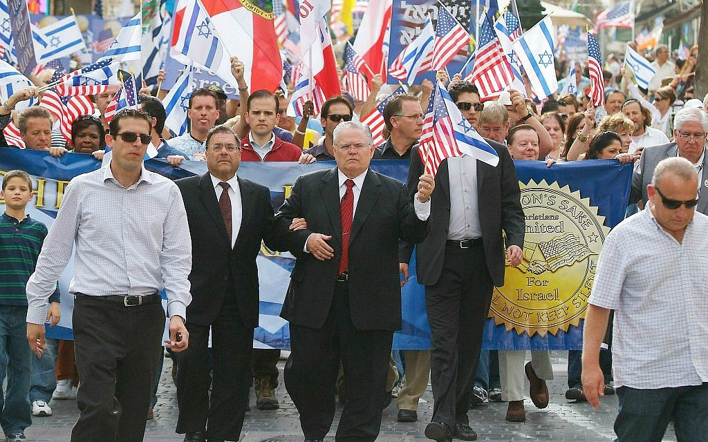 File: Pastor John Hagee, center, leads Christians in a solidarity march in Jerusalem in 2010. (Courtesy: CUFI)