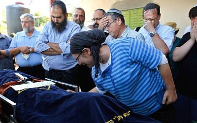 Rina, the mother of 13-year-old Hallel Yaffa Ariel, who was fatally stabbed by a Palestinian terrorist in her home, mourns during her funeral in the Kiryat Arba settlement outside the West Bank city of Hebron, June 30, 2016. (Gil Cohen-Magen/AFP/Getty Images via JTA)