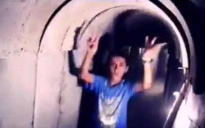 An image taken from a video on Hamas's Facebook page on July 20, 2016 shows Palestinian children inside a tunnel dug by the terror group in the Gaza Strip. (Screen capture from Facebook)