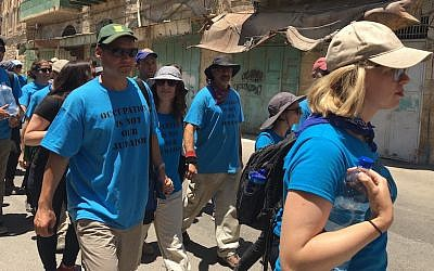 Peter Beinart, left, marching with other activists from the Center for Jewish Nonviolence through the West Bank city of Hebron, July 16, 2016. On the right is the movement's CEO, Ilana Sumka. (Andrew Tobin)