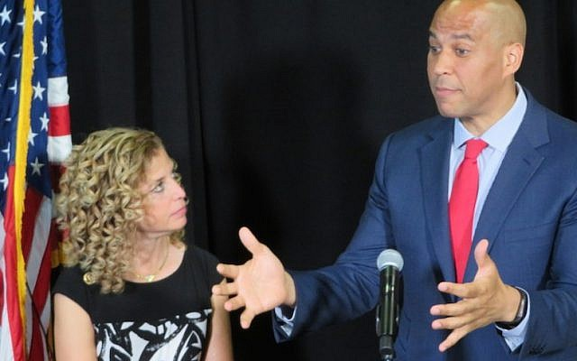 "Sen. Cory Booker, D-NJ, right, speaks out against what he calls the ""hate"" emanating from the republican convention in Cleveland while Rep. Debbie Wasserman Schultz, D-Fla, the chairwoman of the Democratic National Committee, looks on, on July 21, 2016. (Ron Kampeas)"