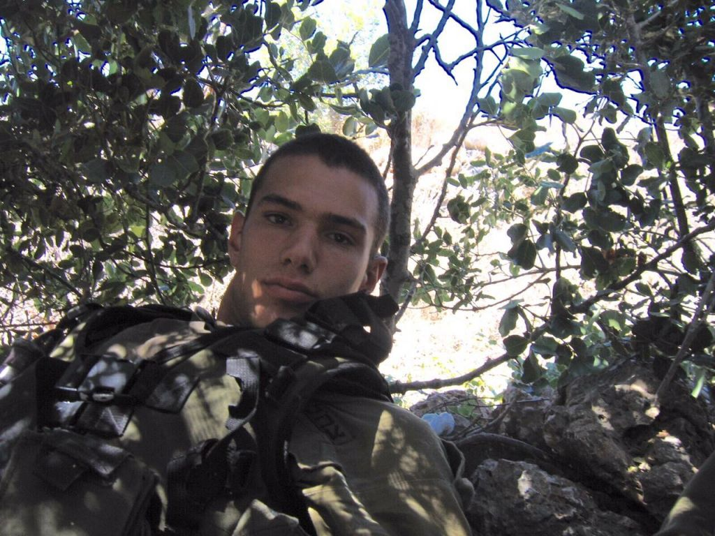 Then Staff Sgt. Ariel Barbi sits under a tree during the Second Lebanon War. (courtesy)