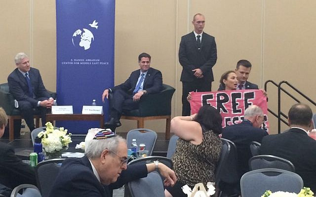 CodePink activist Ariel Gold interrupts Israeli Ambassador to the US Ron Dermer at an event during the 2016 Democratic National Convention (Eric Cortellessa/Times of Israel)