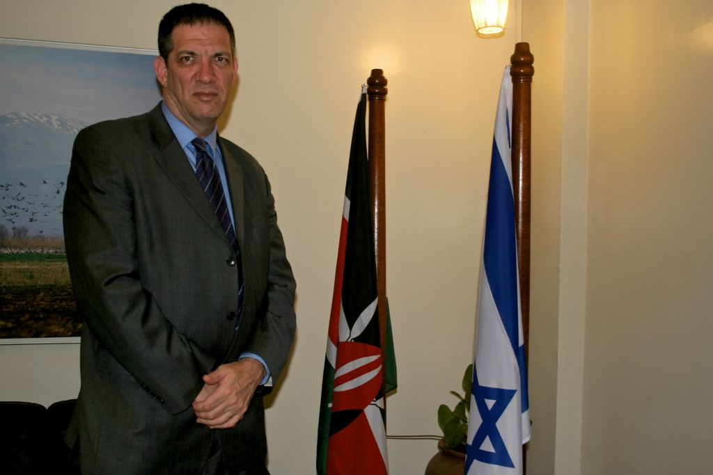 Israeli ambassador to Kenya, Yahel Vilan, standing next to Israeli and Kenyan flags. (Courtesy)