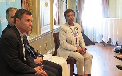 Rep. Yvette Clarke, D-N.Y., speaks Tuesday, July 26 at a J Street panel held near the Democratic National Convention in Philadelphia. At left is journalist Peter Beinart, and behind him pollster Jim Gerstein. (JTA)