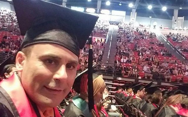 Robin Shahini during his May 2016 International Security and Conflict Resolution San Diego State University graduation ceremony (Shahini Family Photo via AP)