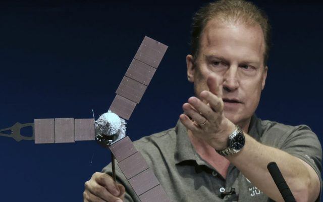 Rick Nybakken, Juno project manager, holds a model of the Juno spacecraft while talking about the solar panels and the orbit it will take around Jupiter during a briefing at the Jet Propulsion Laboratory in Pasadena, California, on Monday, July 4, 2016. (AP Photo/Richard Vogel)
