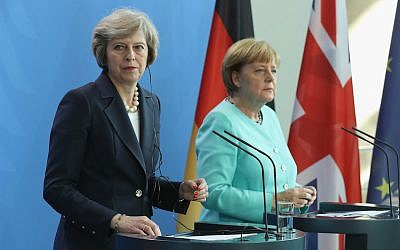 British Prime Minister Theresa May, left, and German Chancellor Angela Merkel speaking to the media following talks at the Chancellery in Berlin, July 20, 2016. (Sean Gallup/Getty Images/via JTA)