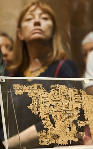A visitor looks at one of the oldest papyri in the history of Egyptian writing among the collection of King Khufu papyri discovered at Wadi El-Jarf port, as it is on display for the first time at the Egyptian museum in Cairo, Egypt, Thursday, July 14, 2016. (AP/Amr Nabil)