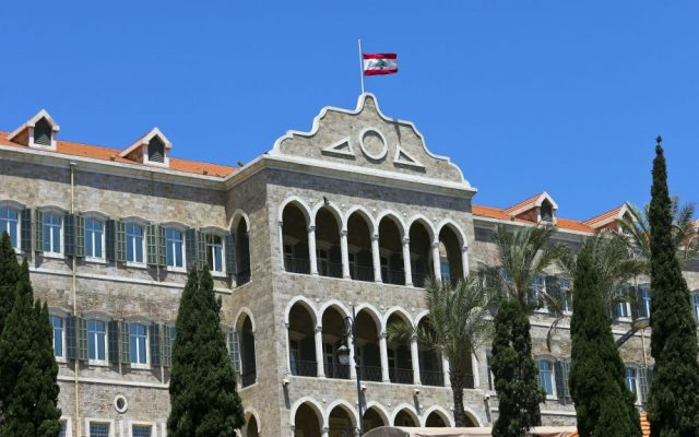 The Lebanese flag flies at half staff atop Government House in Beirut to pay respect to victims of Monday's terror attacks in the eastern Lebanese village of Qaa, in downtown Beirut, Tuesday, June 28, 2016. (AP Photo/Hassan Ammar)