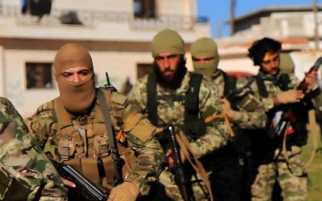File: An undated photo of fighters from al-Qaeda's branch in Syria, the al-Nusra Front, marching toward the northern village of al-Ais in Aleppo province. (Al-Nusra Front via AP)