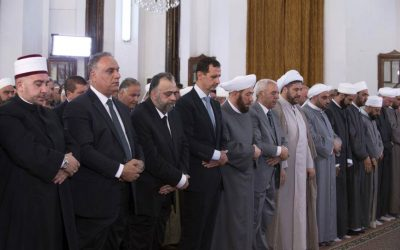 Syrian President Bashar Assad prays on the first day of Eid al-Fitr, that marks the end of the Muslim holy month of Ramadan, at the Safa Mosque, in Homs, Syria, July 6, 2016. (Syrian Presidency via Facebook)