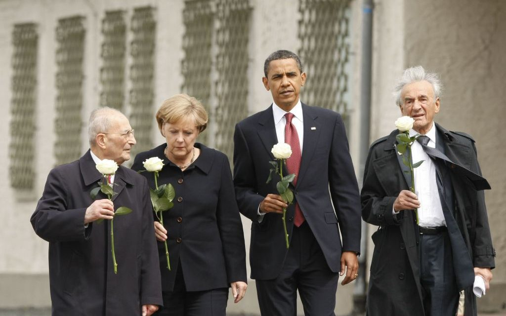 In this June 5, 2009 file photo, U.S. President Barack Obama tours the Buchenwald concentration camp in Buchenwald, Germany. From left are, Holocaust survivor Bertrand Herz, German Chancellor Angela Merkel, the president and Elie Wiesel. (AP Photo/Gerald Herbert)