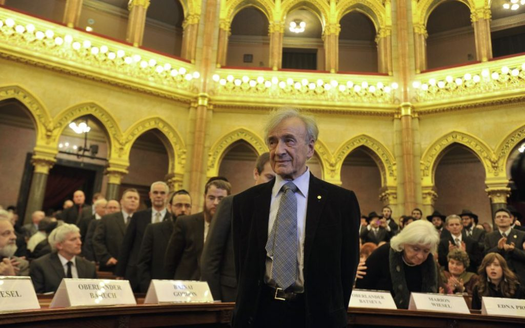 Elie Wiesel arrives in the Hungarian Parliament building in Budapest in 2009. (AP Photo/Bela Szandelszky, file)