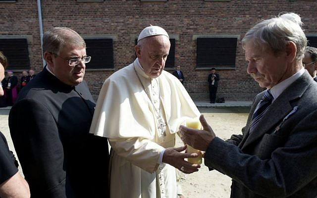 Pope Francis meets with camp survivors in the former Nazi German death camp of Auschwitz--Birkenau in Oswiecim, Poland, Friday, July 29, 2016. (L'Osservatore Romano /Pool Photo via AP)