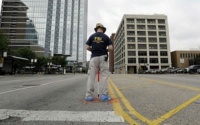 Investigators work in downtown Dallas on Saturday, July 9, 2016 where five police officers were shot dead by a gunman on Thursday. (AP Photo/Eric Gay)