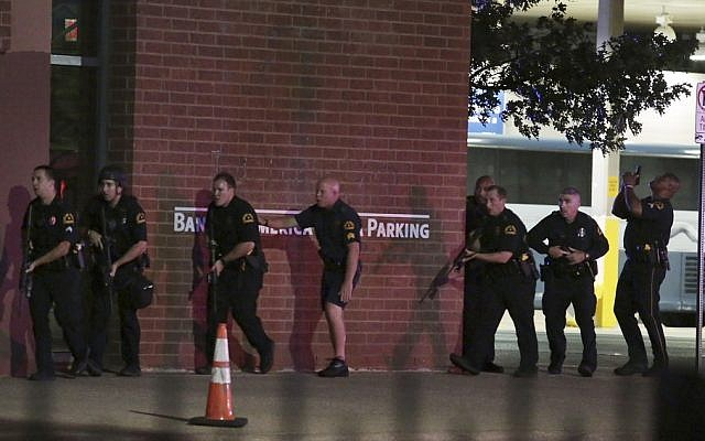 Dallas police respond after shots are fired by a sniper, killing five police officers on July 7, 2016 (Maria R. Olivas/The Dallas Morning News via AP)