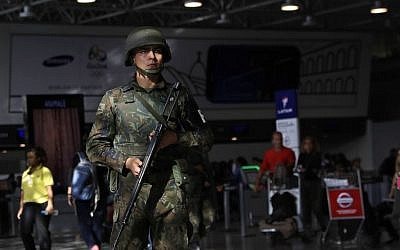A police officer patrols inside Rio de Janeiro International Airport in Rio de Janeiro, Brazil, Wednesday, July 27, 2016. (AP Photo/Patrick Semansky)