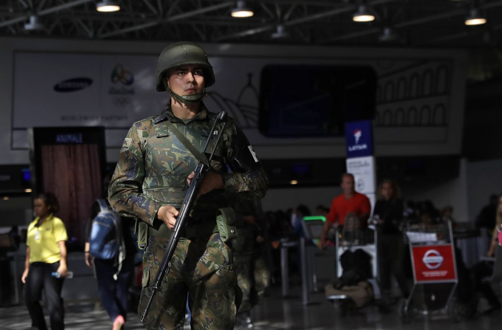 Illustrative: A police officer patrols inside Rio de Janeiro International Airport in Rio de Janeiro, Brazil, Wednesday, July 27, 2016. (AP Photo/Patrick Semansky)
