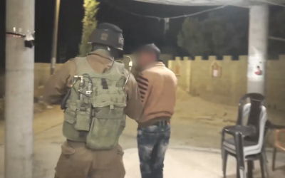 Israeli soldiers arrest two brothers of Muhammad Tarayrah, a Palestinian teenager who stabbed 13-year-old Hallel Yaffa Ariel in the Kiryat Arba settlement near Hebron, during an early morning raid  in the West Bank village of Bani Na'im on July 4, 2016. (Screen capture: IDF Spokesperson's Unit)