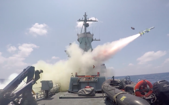 An Israel Navy ship fires a Harpoon sea-to-sea missile at a decommissioned boat during an exercise on July 5, 2016. (Screen capture: IDF Spokesperson's Unit)