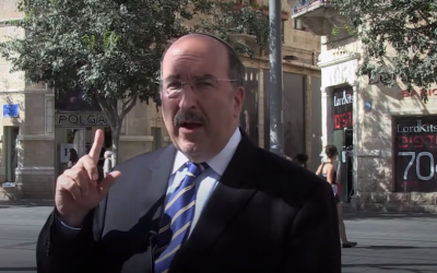 Foreign Ministry director-general Dore Gold standing on Zion Square in Jerusalem, where he witnessed a deadly terror attack in 1975 (screen grab YouTube)