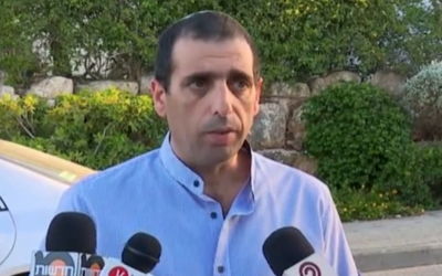 Ofek Buchris speaks to reporters outside his Galilee home after an indictment was filed against him, charging the brigadier general with rape, sodomy and other indecent acts on July 21, 2016. (Screen capture: Walla news)