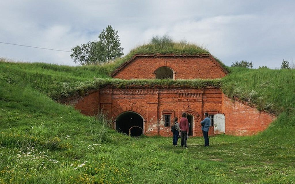 A film crew preparing to record at the former concentration camp known as the Seventh Fort in Kaunas, Lithuania, July 12, 2016. (Cnaan Liphshiz)