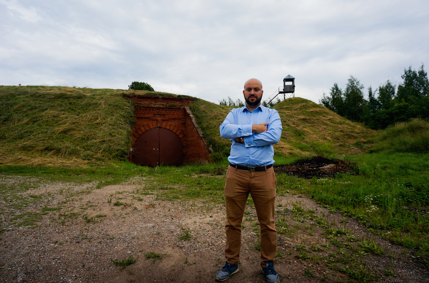 Jonny Daniels, founder of the Poland-based Holocaust commemoration group From the Depths, at the entrance to the Seventh Fort in Kaunas, Lithuania, July 12, 2016. (Cnaan Liphshiz)