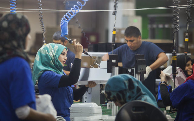 Employees working at the SodaStream factory in Israel's Negev Desert next to the city of Rahat, September 2, 2015. (Dan Balilty/AP Images)