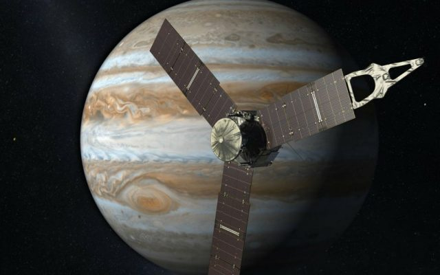 This artist's rendering provided by NASA and JPL-Caltech shows the Juno spacecraft above the planet Jupiter