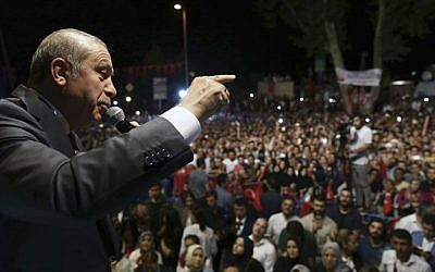 Turkey's President Recep Tayyip Erdogan addresses his supporters gathered in front of his residence in Istanbul, early Tuesday, July 19, 2016. (Kayhan Ozer/pool photo via AP)