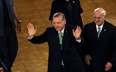 Turkey's President Recep Tayyip Erdogan waves after his address at the parliament in Ankara, Turkey, Friday, July 22, 2016. (AP Photo/Burhan Ozbilici)