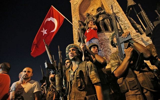 Turkish soldiers secure the area, as supporters of Turkey's President Recep Tayyip Erdogan protest in Istanbul's Taksim square, early Saturday, July 16, 2016. (AP Photo/Emrah Gurel)