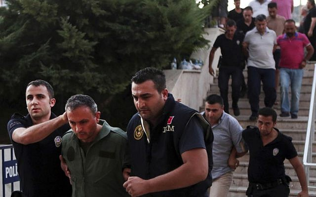 Members of Turkey armed forces are escorted by police for their suspected involvement in Friday's attempted coup at the court house in Mugla, a Mediterrenean city of Turkey, Sunday, July 17, 2016. (Tolga Adanali/Depo Photos via AP)