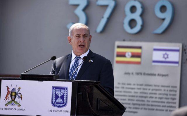 Prime Minister Benjamin Netanyahu gives a speech after his arrival at Entebbe airport, Uganda, Monday, July 4, 2016. (AP Photo/Stephen Wandera)