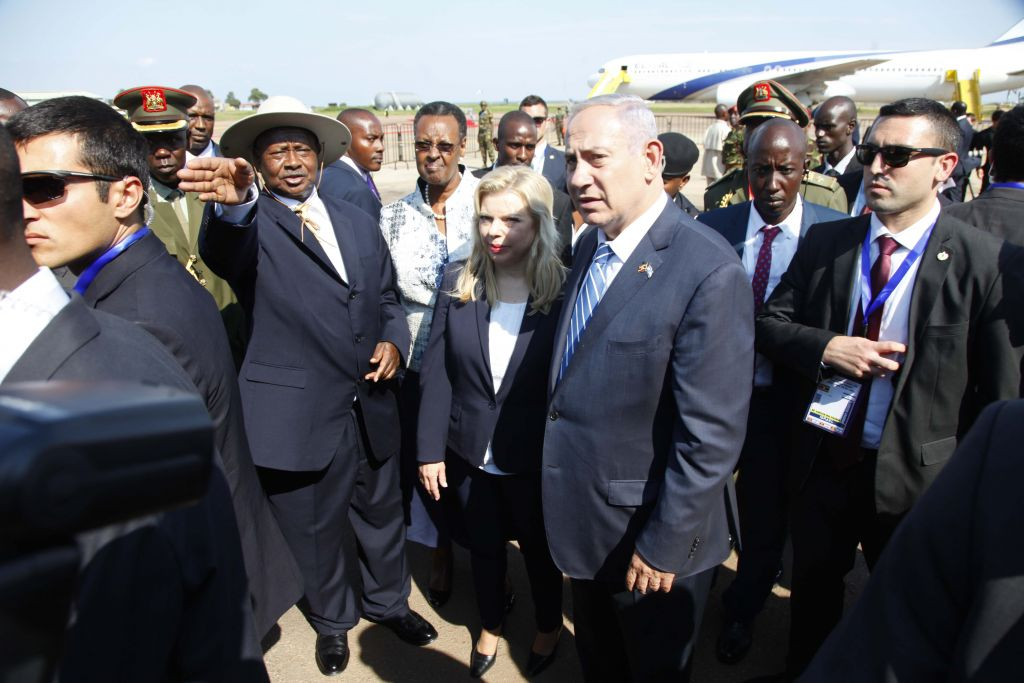Prime Minister Benjamin Netanyahu, with Ugandan President Yoweri Museveni, after his arrival at Entebbe airport, Uganda, Monday, July 4, 2016. (AP Photo/Stephen Wandera)