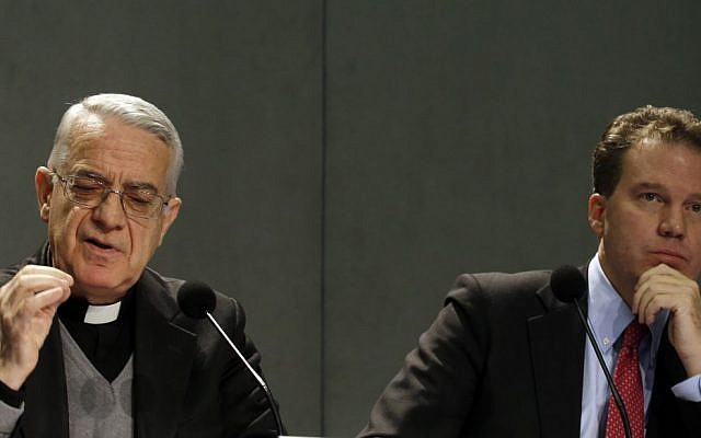 In this, Monday, Dec. 3, 2012 file photo, Vatican spokesman Father Federico Lombardi, left, and Vatican communications adviser Greg Burke, present Pope Benedict XVI's Twitter web page to journalists at the Vatican press hall. (AP Photo/Gregorio Borgia)