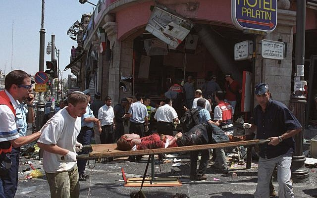 The aftermath of a suicide bombing at a Sbarro restaurant in Jerusalem in August 9, 2001, that killed 15 and wounded over 100 more. (Flash90)