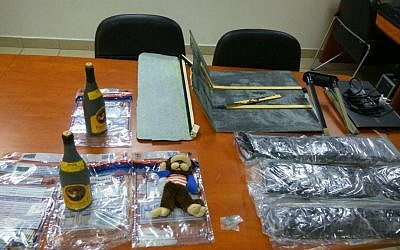 Bottles of wine filled with MDMA and a suitcase saturated with the illegal drug, caught by police at Ben Gurion Airport on July 31, 2016. (Israel Police)