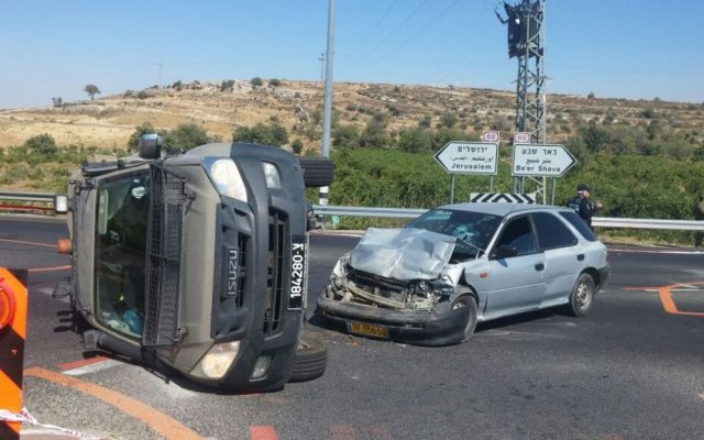 An IDF jeep and Palestinian vehicle after a possible car-ramming attack outside the Neve Daniel settlement in the West Bank on July 6, 2016. (Israel Police)