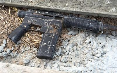Part of an M-16 assault rifle found during a raid by Israeli security forces in Urif, outside of Nablus, as part of a crackdown on illegal weapons in the West Bank on July 10, 2016. (Shin Bet)