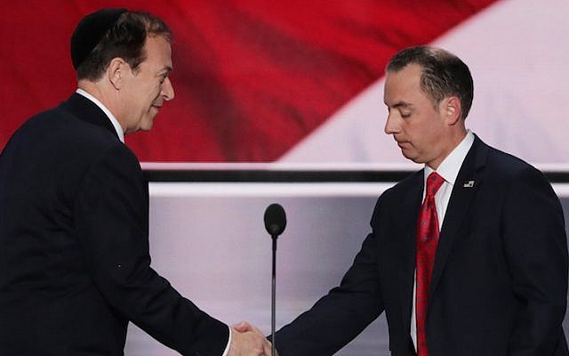 Rabbi Ari Wolf, left, shaking hands with Reince Priebus, chairman of the Republican National Committee, at the start of the first day of the Republican National Convention at the Quicken Loans Arena in Cleveland, July 18, 2016. (Alex Wong/Getty Images via JTA)
