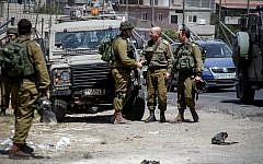 Illustrative. IDF soldiers at the Al-Aroub intersection near Hebron, July 18, 2016. (Wisam Hashlamoun/Flash90)