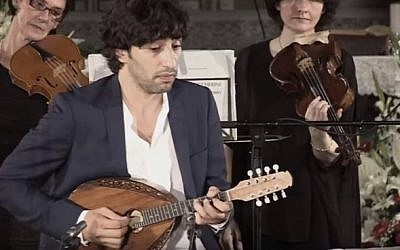 Israeli mandolin virtuoso Avi Avital performs Vivaldi's Mandolin Concerto in C Major with the Venice Baroque Orchestra on June 2, 2015.  (screen capture: YouTube)