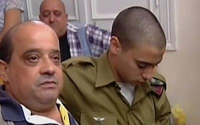 Charlie Azaria, left, with his son Elor Azaria in Jaffa military court on July 5, 2016. (screen capture: Channel 2)