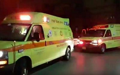 Magen David Adom ambulances evacuating wounded people to Soroka Hospital Beersheba after a brawl in the Bedouin community of Kuseife, July 31, 2016. (YouTube/Times of Israel)