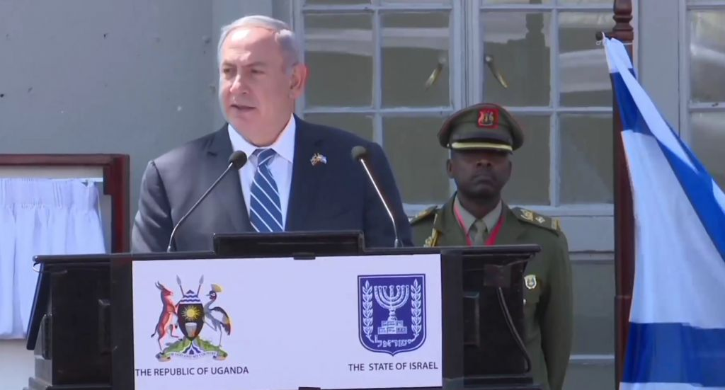 Prime minister Benjamin Netanyahu, gives a speech after his arrival at Entebbe airport Uganda, Monday, July 4, 2016. Netanyahu is on a four-nation Africa tour to Uganda, Kenya, Rwanda and Ethiopia. (AP Photo/Stephen Wandera)