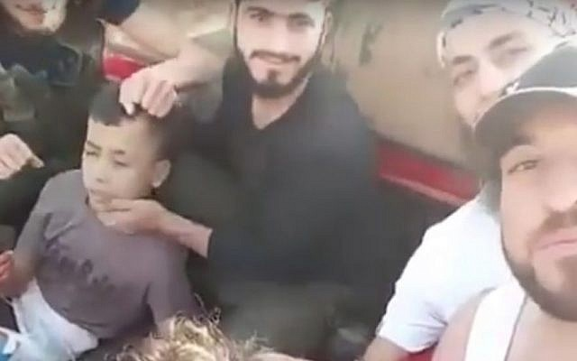 A boy captured by Syrian rebels before being beheaded, in a video released June 19, 2016. (screen capture: YouTube)